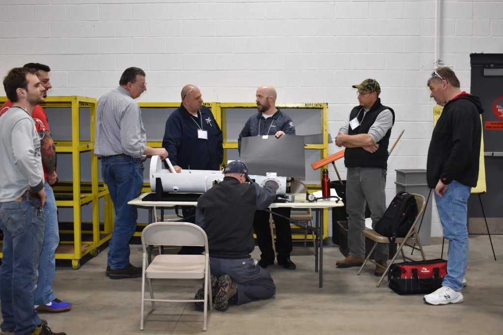 ROUSH CleanTech technicians discuss the benefits of propane-fueled school buses with school district representatives during one of the many district propane bus meet-n-greets that they have held in conjunction with district and bus vendor partners. There are over 10,500 Blue Bird Vision Propane buses in operation across North America.