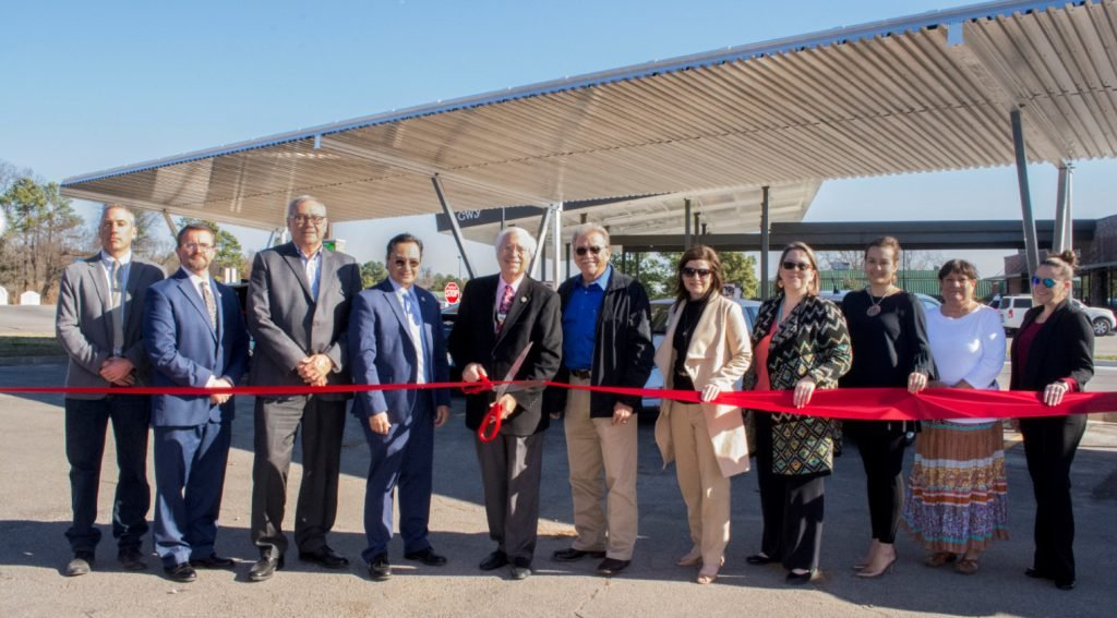 Ribbon cutting ceremony at solar canopy charging station