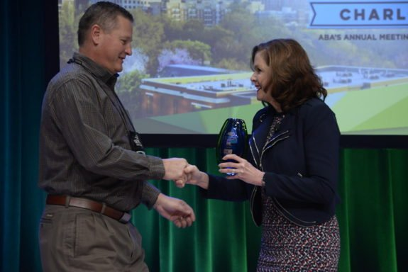 INL Transportation Services Manager Tad Person accepts American Bus Association Green Spirit award at an event in January 2018.